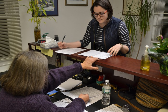 Brianna DeVivo (right), president of the UConn College Democrats, discussed talking points with Democratic Councilwoman Toni Moran at the Mansfield Democrats' phone bank. The UConn College Democrats provided support to the Mansfield Democrats throughout the campaign. (Amar Batra/The Daily Campus)