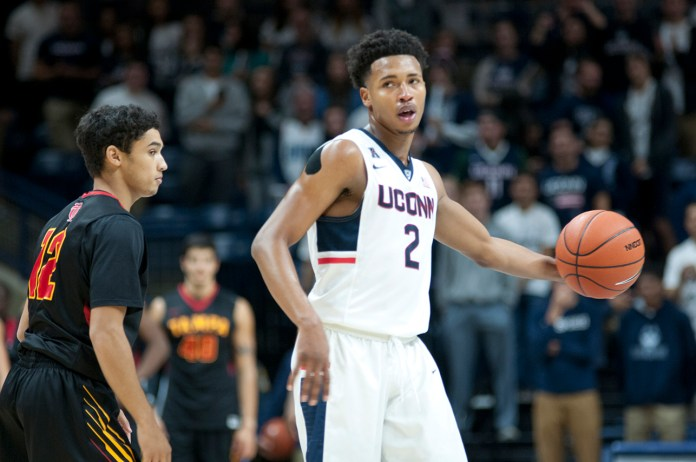 Freshman guard Jalen Adams (#2) looks to make a play during UConn's exhibition against University of Tampa. Adams hails from the same hometown as UConn legend Shabazz Napier. (Bailey Wright/The Daily Campus)