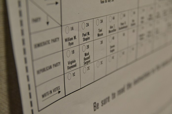 In this photo, a sample ballot from the Mansfield Municipal Election is seen. (Amar Batra/The Daily Campus)