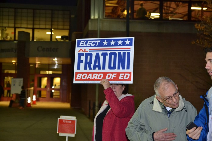Supporters stayed at the polls well into the evening in order to potentially sway any last-minute voters. (Amar Batra/The Daily Campus)