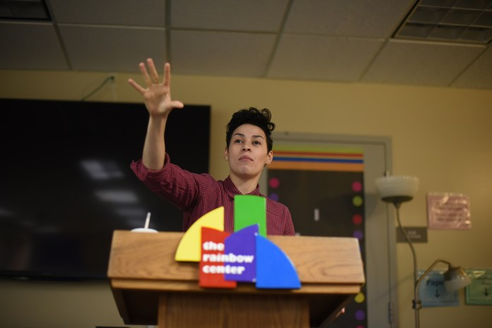 """Award-winning poet and educator Denice Frohman speaks to students, alumni and staff at the Rainbow Center on Thursday, Nov. 5, 2015 during her lecture """"Resistance, Otherness and Examining the Performance of Sexuality/Gender."""" (Allen Lang/The Daily Campus)"""