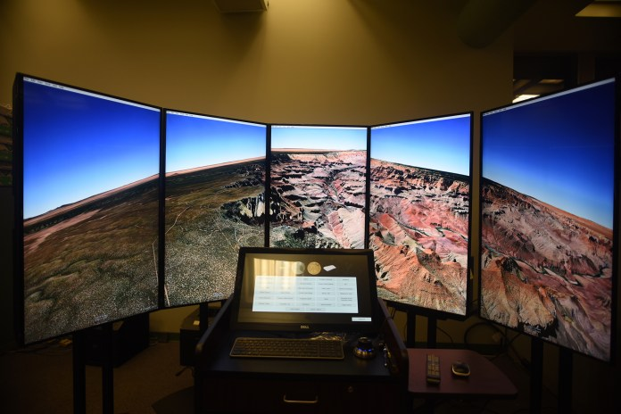 In this photo, the Liquid Galaxy –a data visualization tool for working with Google Earth images of the Earth, Moon and Mars – is seen in UConn's Homer D. Babbidge Library on Tuesday, Nov. 3, 2015. (Allen Lang/The Daily Campus)