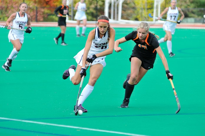 UConn field hockey forward Charlotte Veitner protects the ball during the Huskies' game against Princeton at the Sherman Family Sports Complex in Storrs, Connecticut on Sunday, Oct. 25, 2015.Veitner was named the Big East tournament's Most Outstanding Player, and also made the All-Tournament Team. (Jason Jiang/The Daily Campus)
