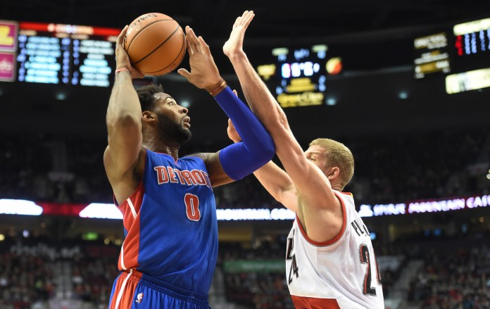 Detroit Pistons center Andre  Drummond (0) drives to the basket on Portland Trail Blazers center Mason Plumlee (24) during the first quarter of an NBA basketball game in Portland, Ore., Sunday, Nov. 8, 2015. (AP).