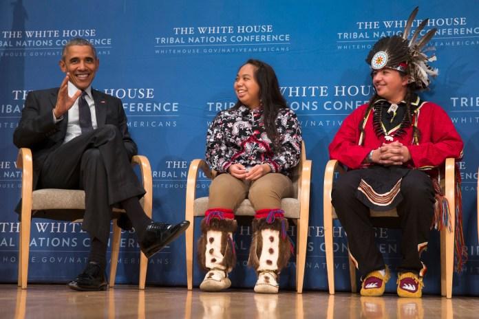 Brayden White of the St. Regis Mohawk Tribe, right, and Tatiana Ticknor of the Yup'ik/Tlingit/Dena'ina, listen as President Barack Obama speaks during the 2015 White House Tribal Nations Conference, Thursday, Nov. 5, 2015, in Washington. (Evan Vucci/AP)