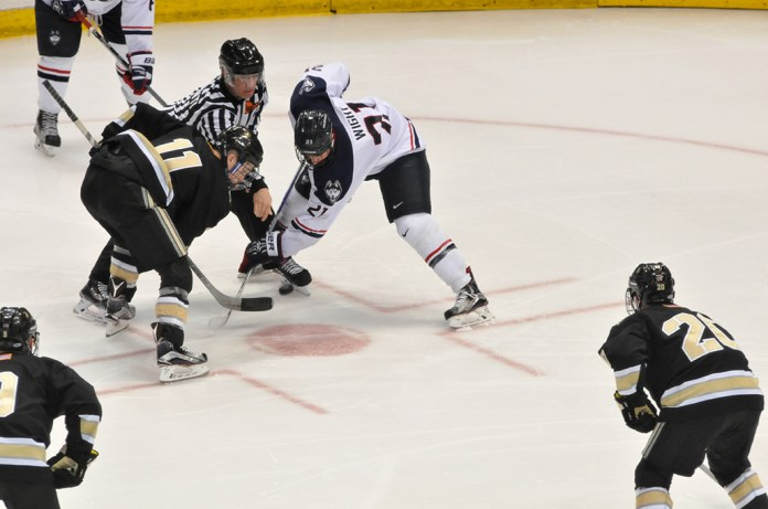 UConn sophomore forward Jeff Wight takes a faceoff during the Huskies' game against Army at XL Center in Hartford, Connecticut on Tuesday, Nov. 10, 2015. (Amar Batra/The Daily Campus)