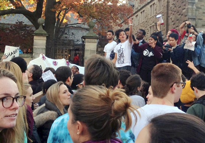Yale University students and supporters participate in a march across campus to demonstrate against what they see as racial insensitivity at the Ivy League school on Monday, Nov. 9, 2015, in New Haven, Conn. (Ryan Flynn/New Haven Register via AP)