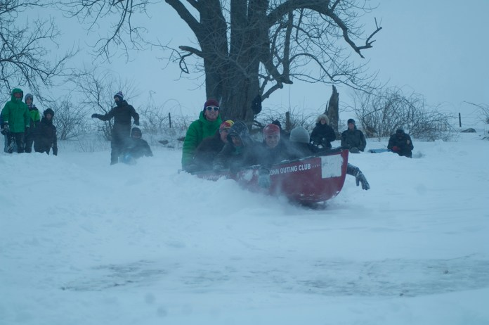 """In this file photo, students are seen sledding on Horsebarn Hill after the """"Snowmaggedon 2015"""" snow storm in late-January 2015. (File Photo/The Daily Campus)"""