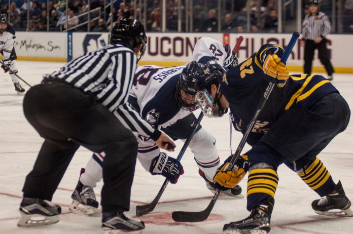 UConn senior forward Joey Ferriss takes a face off during the Huskies' game against Quinnipiac at the XL Center in Hartford, Connecticut on Tuesday, Nov. 17, 2015. UConn lost 6-2, extending its losing streak to seven games. (Courtesy/Stephen Quick)