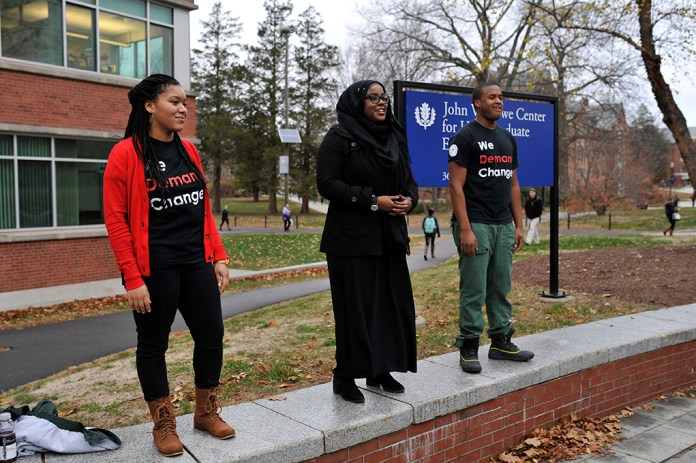 Event organizers (left to right) Charity Whitehead, Haddiyyah Ali and Justin Rose address the crowd during the Speak Out on Fairfield Way in Storrs, Connecticut on Thursday, Nov. 19, 2015. (Jason Jiang/The Daily Campus)