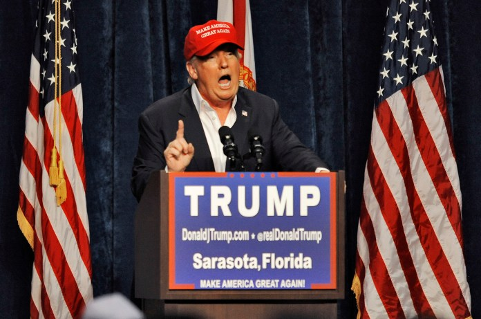 """Republican presidential candidate Donald Trump speaks to supporters at a campaign rally Saturday, Nov. 28, 2015 at Robarts Arena in Sarasota, Fla. Trump bragged about his high standing in the polls, slammed super PACS as """"a scam"""" and dismissed nomination rivals Marco Rubio and Jeb Bush in a campaign stop Saturday in their home state of Florida. (Steve Nesius/AP)"""