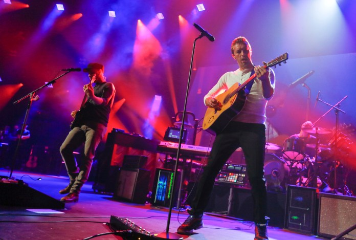 In this March 11, 2014 file photo, Coldplay performs at the iTunes Festival during the SXSW Music Festival in Austin, Texas. Coldplay will perform at the Pepsi Super Bowl 50 Halftime Show on CBS Sunday, Feb. 7, 2016, the NFL announced on Thursday, Dec. 3, 2015. (Jack Plunkett/Invision/AP, File)