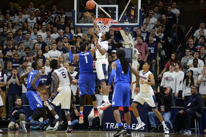 Forward Kentan Facey blocks a shot during UConn's 81-78 vicotry over Memphis on Jan. 9 at Gampel Pavilion. He finished with 5 blocks to go along with 7 points and 5 rebounds. (Ashley Maher/The Daily Campus)