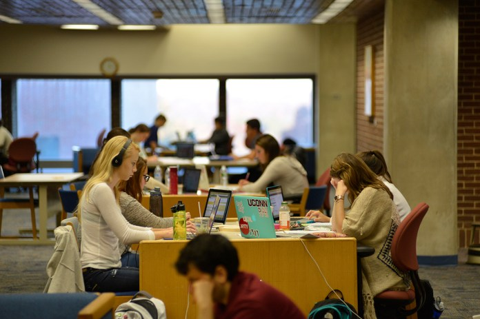 Stressful students look to survive studying at the library.Students studying at all hours of the day is a common occurrence in college. (Jason Jiang/The Daily Campus)