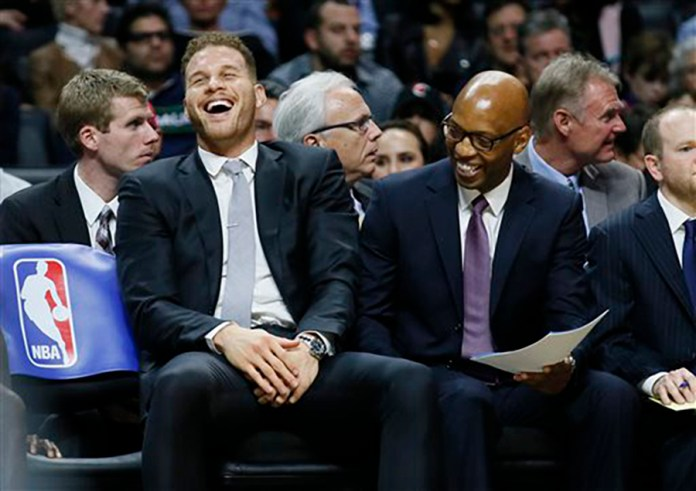 What's Blake Griffin laughing about? Probably not his recent fight with a trainer. Los Angeles Clippers' Blake  Griffin , left, laughs on the bench with assistant coach Sam Cassell, right, during the second half of an NBA basketball game Wednesday, Jan. 13, 2016, in Los Angeles. The Clippers won 104-90. (AP Photo/Danny Moloshok)
