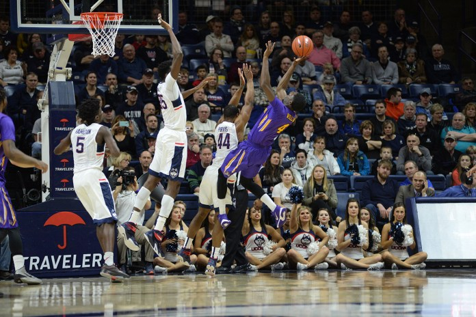 Left to right:Daniel Hamilton (5), Amida Brimah (35) and Rodney Purvis (44) force a tough shot from East Carolina's Prince Williams on during UConn's 85-67 victory at Gampel Pavilion. The Huskies swarming defense held ECU to 37.1 percent shooting. (Ashley Maher/The Daily Campus)