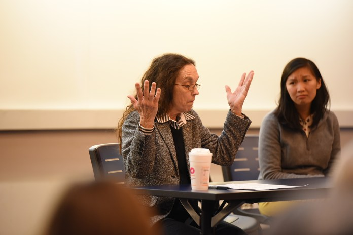 """The human tendency toward selective attention to detail, especially where women are concerned, was a running theme Thursday evening at """"Faith and Feminism,"""" a panel discussion about the intersection of religion and gender. (Allen Lang/The Daily Campus)"""
