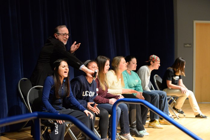 Comedian and hypnotist Jim Spinnato is seen on stage with hypnotized students in the Student Union Theater in Storrs, Connecticut on Thursday, Feb. 11, 2016.(Amar Batra/The Daily Campus)
