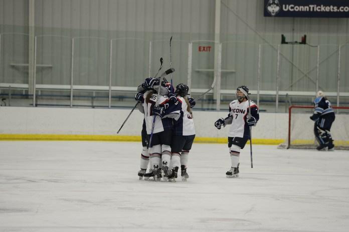 The UConn women's hockey team celebrates a goal against Maine at Freitas Ice Forum on Saturday Feb. 13, 2016. (Amar Batra/The Daily Campus)