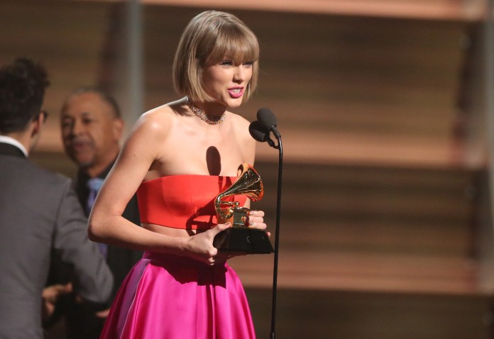 """Taylor Swift accepts the award for album of the year for """"1989"""" at the 58th annual Grammy Awards on Monday, Feb. 15, 2016, in Los Angeles. (Matt Sayles/Invision/AP)"""