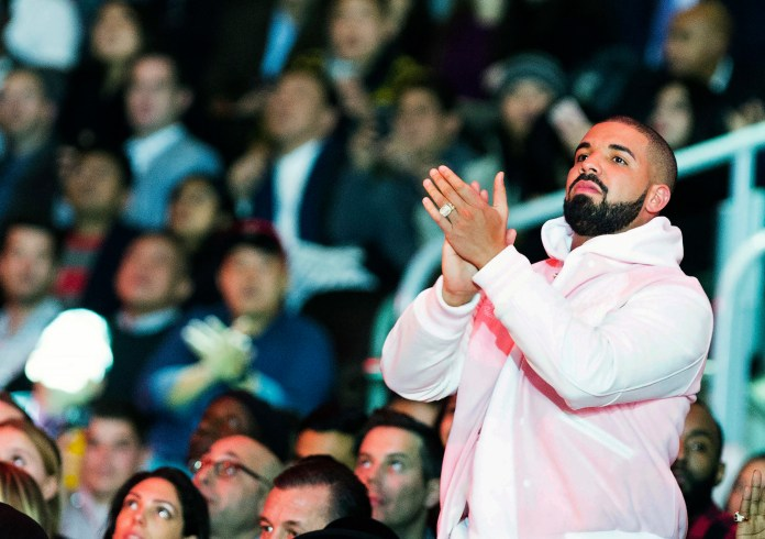Rapper Drake watches the NBA all-star skills competition from court side in Toronto on Saturday, Feb. 13, 2016. (Mark Blinch/The Canadian Press via AP)