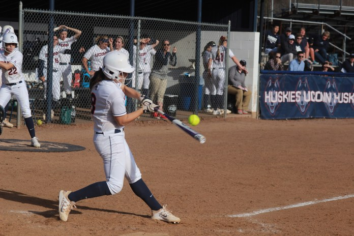 UConn softball senior infielder Lexi Gifford makes contact during the Huskies' game against Central Connecticut State at the Connecticut Softball Stadium in Storrs, Connecticut on April 15, 2015. (File Photo/The Daily Campus)