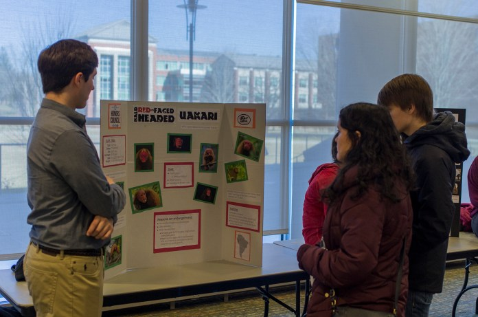 A member of UConn's Honors Council Environmental Committee speak with students during the 2nd Annual Ugliest Endangered Species Competition in the UConn Student Union in Storrs, Connecticut on Saturday, Feb. 27, 2016. (The Daily Campus)