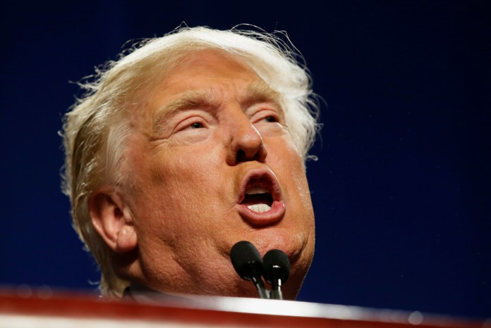 In this Friday, Feb. 26, 2016 photo, Republican presidential candidate Donald Trump speaks to supporters during a rally in Fort Worth, Texas. To his supporters, the business career of Trump shows he's got the decisiveness and smarts to lead the country. To critics, his exaggerated claims, burned customers and four bankruptcies suggest a man wholly disqualified for the office. (AP Photo/LM Otero)