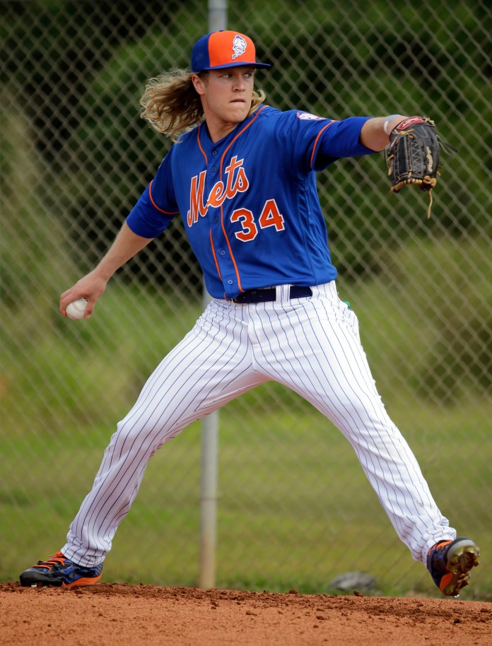 New York Mets pitcher Noah Syndergaard throws a bullpen session during spring training baseball practice Saturday, Feb. 20, 2016, in Port St. Lucie, Fla. (AP Photo/Jeff Roberson)