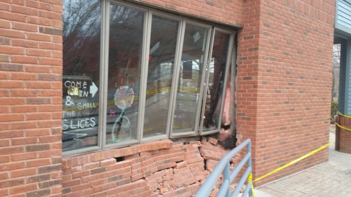 The damaged Sgt. Pepperoni's storefront after a car crashed into it late Thursday, March 3, 2016.No injuries were reported. (Sarah McNeal/The Daily Campus)