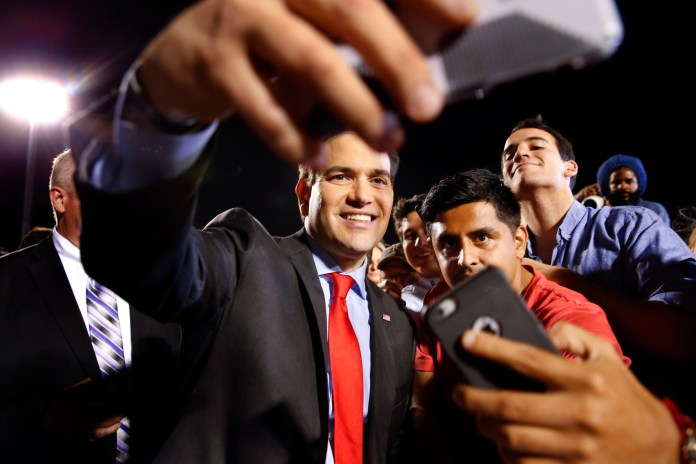 Republican presidential candidate, Sen. Marco Rubio, R-Fla., poses for photographs during a campaign rally in Hialeah, Fla., Wednesday, March 9, 2016. (AP Photo/Paul Sancya)