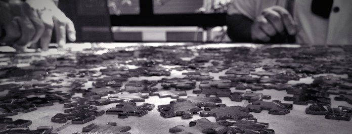 The daily jigsaw puzzle, providing casual challenge and conversation. (Kevin Dooley/Flickr)