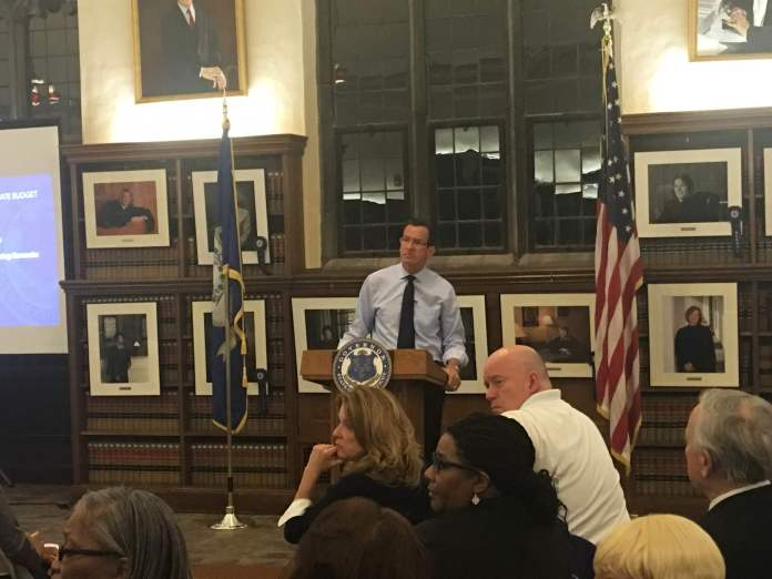 Gov. Dannel P. Malloy answered questions from concerned Connecticut residents about taxes and lay-offs, what Malloy explained was often a trade-off. The town hall was held in the reading room of the University of Connecticut Law School in Hartford. (Kyle Constable/Daily Campus)