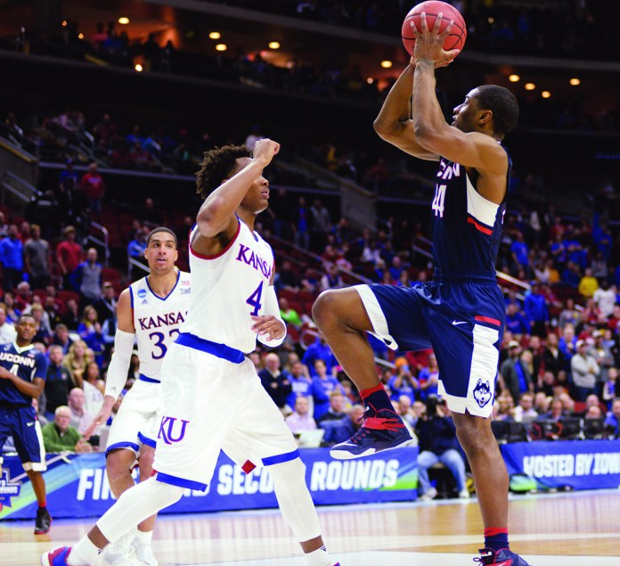 Rodney Purvis takes a shot against No. 1 Kansas on Saturday, March 19 at the Wells Fargo Arena in Des Moines, Iowa. Purvis scored 17 points en route to a 73-61 loss in the second round of the NCAA tournament. (Ashley Maher/The Daily Campus)