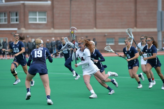 Freshman midfielder Brooke Jensen (14) cuts through Villanova defenders in a game at the George J. Sherman Family Sports Complex on Saturday, March 26. UConn defeated the Wildcats 13-8.(Amar Batra/The Daily Campus)