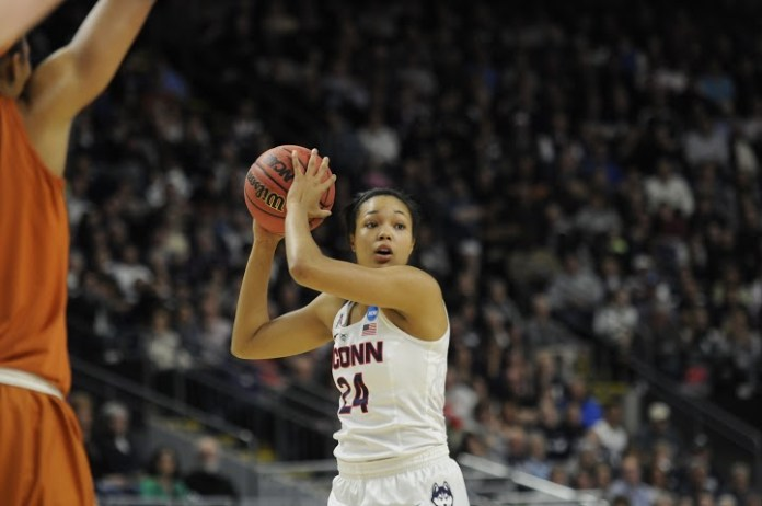 Freshman forward Napheesa Collier looks to pass the ball during an 86-65 victory over Texas in the Elite Eight on Monday March 28 at the Webster Bank Arena in Bridgeport, Connecticut. Collier had nine points and four rebounds off the bench. (Bailey Wright/The Daily Campus)
