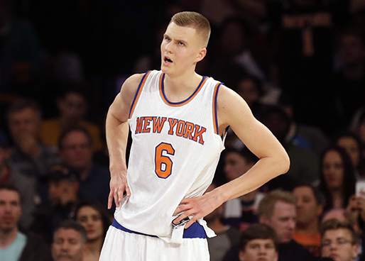 New York Knicks' Kristaps  Porzingis reacts during the second half of the NBA basketball game Sacramento Kings, Sunday, March 20, 2016 in New York. The Kings defeated the Knicks 88-80. (AP Photo/Seth Wenig)