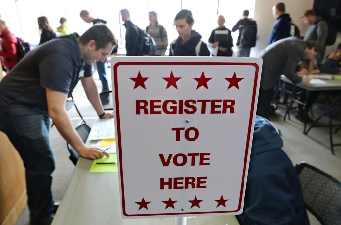 Students wait in long lines as register and vote at UW-Eau Claire Davies Center on Tuesday, April 5, 2016 in Eu Claire, Wis. Wisconsin voters are expected to turn out Tuesday in large numbers for the presidential  primary and statewide races.(Dan Reiland/The Eau Claire Leader-Telegram via AP)