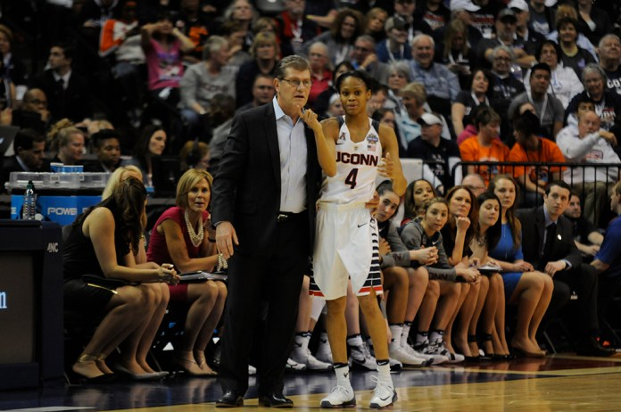 Geno Auriemma, left, and Morian Jefferson, right, go over strategy during the first half of the national championship game between UConn and Syracuse at Bankers Field House in Indianapolis, Ind. on Tuesday April 5, 2016. Jefferson was the #2 prospect in 2012, behind only Breanna Stewart. (Bailey Wright/The Daily Campus)