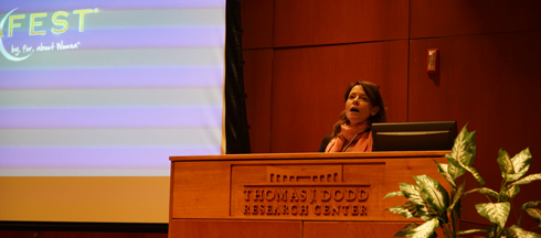 Kathy Fischer, event organizer and associate director of the Women's Center, introduced the featured LUNAFEST films in Konover Auditorium on Tuesday, April 5, 2016. (Erming Gao/Daily Campus)