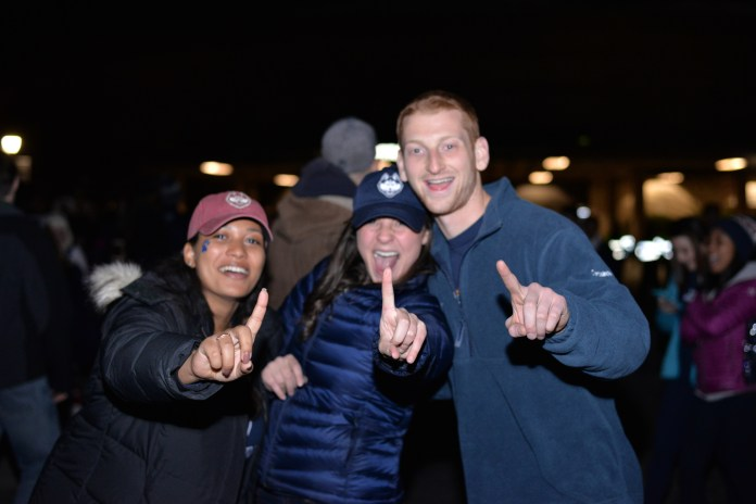 Students celebrate the UConn win outside Gampel Pavillion after the NCAA women's championship game between UConn and Syracuse. The game was played at the Bankers Life Fieldhouse in Indianapolis, Ind., on Tuesday, April 5, 2016.(Amar Batra/Daily Campus)