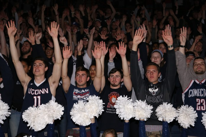 Students cheer in Gampel Pavillion at the screening of the NCAA women's championship game between UConn and Syracuse. The game was played at the Bankers Life Fieldhouse in Indianapolis, Ind., on Tuesday, April 5, 2016.(Jackson Haigis/Daily Campus)