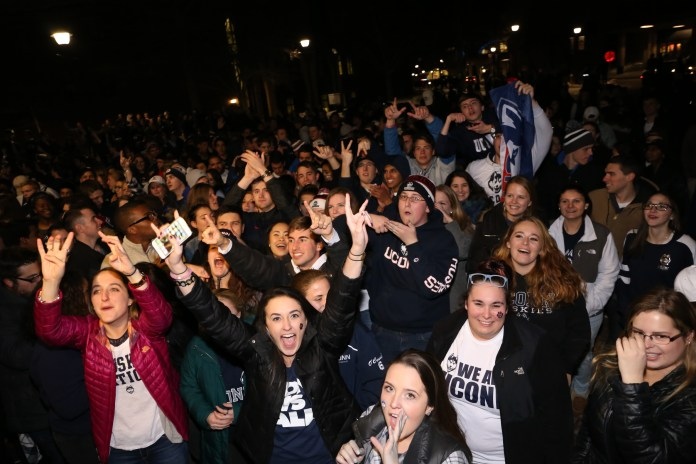 Students celebrate the UConn win outside Gampel Pavillion after the NCAA women's championship game between UConn and Syracuse. The game was played at the Bankers Life Fieldhouse in Indianapolis, Ind., on Tuesday, April 5, 2016.(Jackson Haigis/Daily Campus)