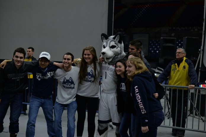 Students and fans take their picture in Gampel Pavillion during the NCAA women's championship game between UConn and Syracuse. The game was played at the Bankers Life Fieldhouse in Indianapolis, Ind., on Tuesday, April 5, 2016.(Amar Batra/Daily Campus)