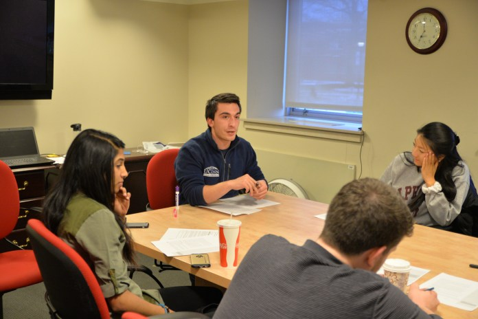Funding Board Chairman Stephen Porcello discusses amendments to Undergraduate Student Government funding policy with senators at caucus Wednesday, April 6, 2016. (Amar Batra/Daily Campus)