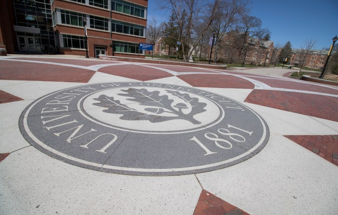 The UConn seal on Fairfield Way between the Homer Babbidge Library and the Rowe Center for Undergraduate Education in Storrs, Connecticut. (Jackson Mitchell/The Daily Campus)