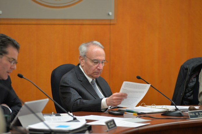 Mansfield Town Council member Paul Shapiro (D) looks at a document during a town council meeting in the Audrey P. Beck Municipal Building in Mansfield, Connecticut on Monday, April 11, 2016. (Amar Batra/The Daily Campus)