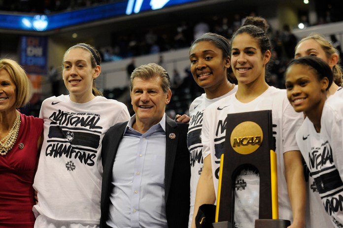 From left: Chris Dailey, Breanna Stewart, Geno Auriemma, Morgan Tuck, Kia Nurse and Moriah Jefferson pose with the national championship trophy following UConn's 82-51 victory over Syracuse at Bankers Life Fieldhouse in Indianapolis, Indiana on Tuesday April 5, 2016. (Bailey Wright/The Daily Campus)