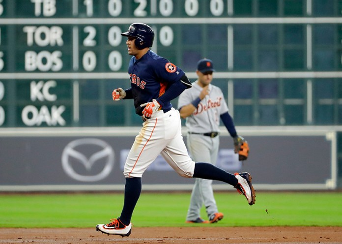 Houston Astros'George Springer runs the bases after hitting a home run against the Detroit Tigers during the third inning of a baseball game Sunday, April 17, 2016, in Houston. (AP Photo/David J. Phillip)