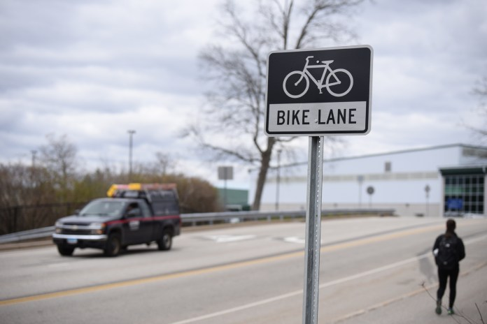 Cars are passing by the bike lane sign located on Discovery Drive on April 18, 2016. (Zhelun Lang)